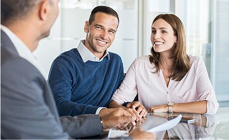 Couple listening to insurance agent